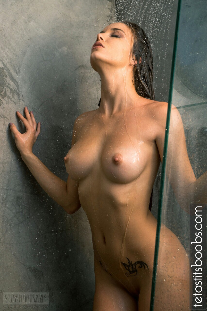 Malena-Morgan-naked-tits-under-the-shower.jpg